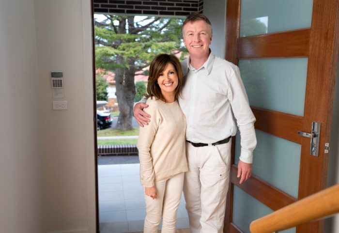 Middle Aged Couple Entering New Home